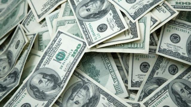 杨安泽等推动了领食品券的家庭1000美元现金的计划